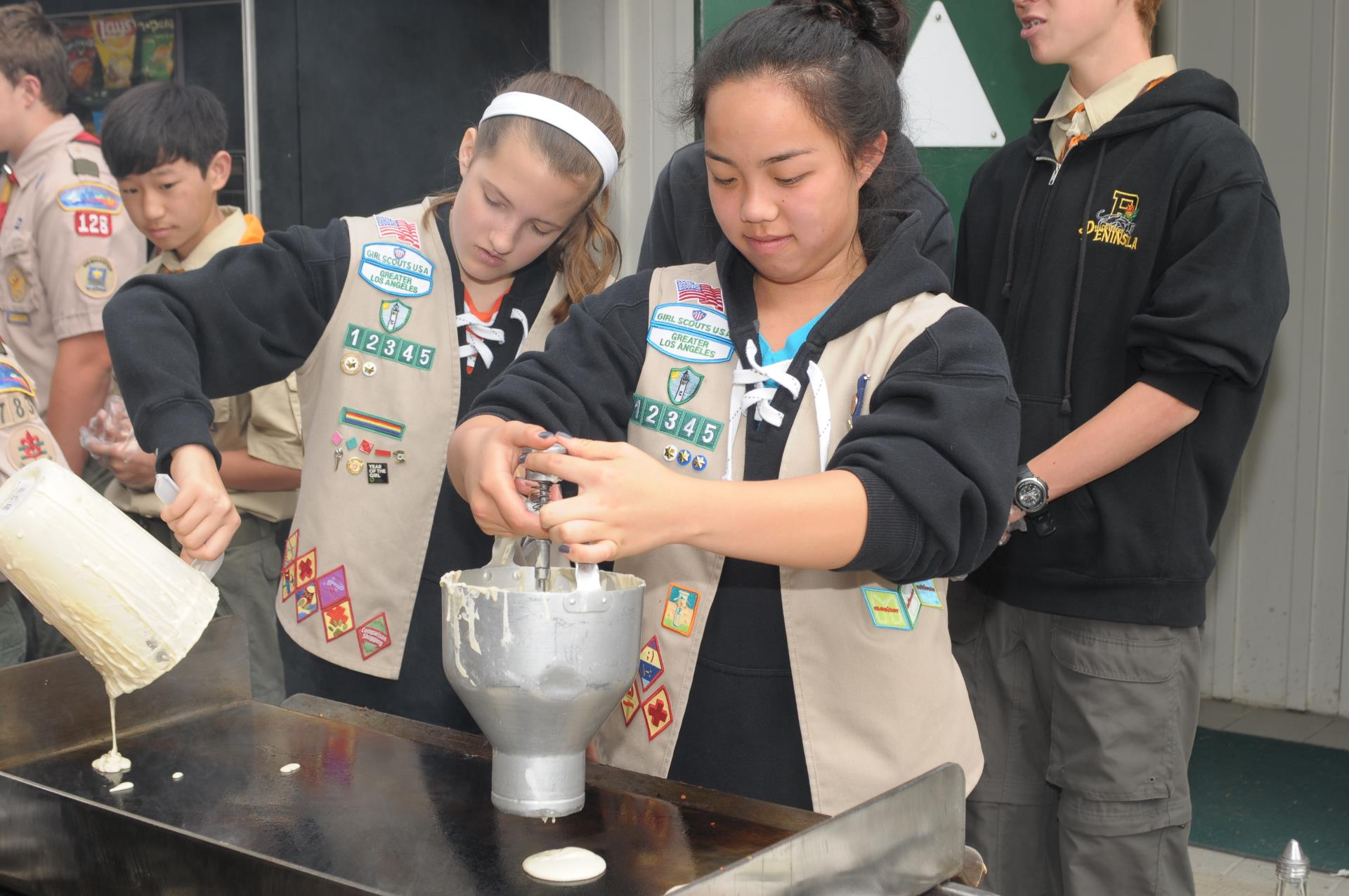 Girl scouts making pancakes at 2015 Mayor's Ride
